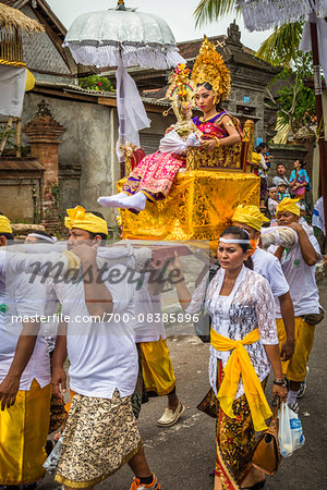 Woman being carried in a raised chair by people in a parade at a cremation ceremony for a high priest in Ubud, Bali, Indonesia Stock Photo - Rights-Managed, Image code: 700-08385896