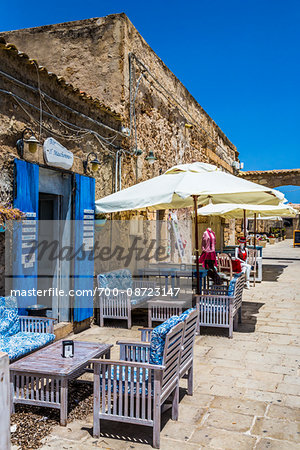 Outdoor cafe and shops along cobblestone street in the village of Marzamemi in the Province of Syracuse in Sicily, Italy Stock Photo - Rights-Managed, Image code: 700-08723147