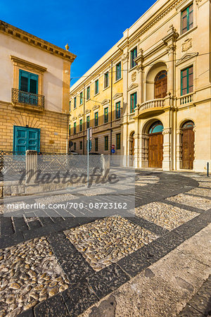 Stone buildings and inlayed designs in the cobblestone streets of Noto in the Province of Syracuse in Sicily, Italy Stock Photo - Rights-Managed, Image code: 700-08723162