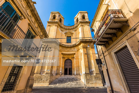 The curved facade and twin towers of the Church of Montevergine (Chiesa di Montevergine) in Noto in the Province of Syracuse in Sicily, Italy Stock Photo - Rights-Managed, Image code: 700-08723167