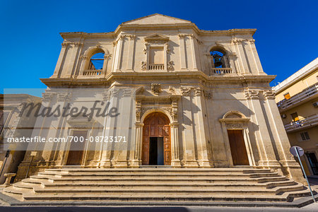 Steps and main entrance of the facade of the Church of the Crucifix (Church of the Holy Cross, Chiesa del SS Crocifissio) in Noto in the Province of Syracuse in Sicily, Italy Stock Photo - Rights-Managed, Image code: 700-08723171