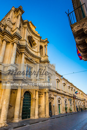 Street view of the Church of Montevergine (Chiesa di Montevergine) against a blue sky in Noto in the Province of Syracuse in Sicily, Italy Stock Photo - Rights-Managed, Image code: 700-08723174
