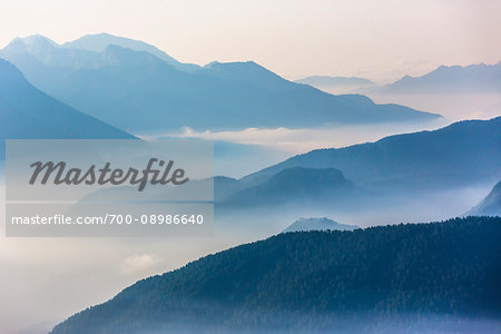 Misty fog over the Dolomites near The Three Peaks of Lavaredo (Tre Cime di Lavaredo), Auronzo di Cadore, Italy