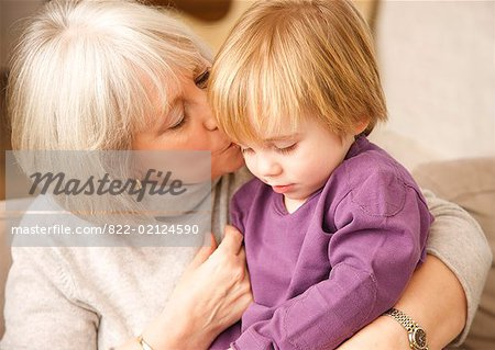 Close up of grey haired grandmother kissing grandchild Stock Photo - Rights-Managed, Image code: 822-02124590