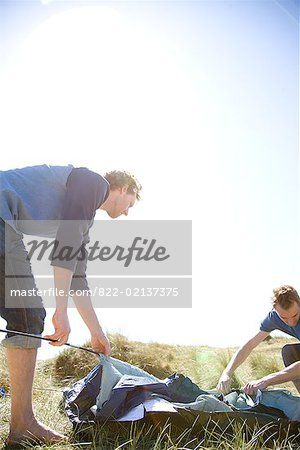 Two young campers erecting tent Stock Photo - Rights-Managed, Image code: 822-02137375
