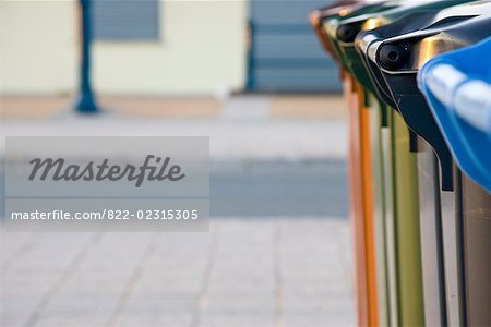 Close up of recycling bins on a paved street Stock Photo - Rights-Managed, Image code: 822-02315305
