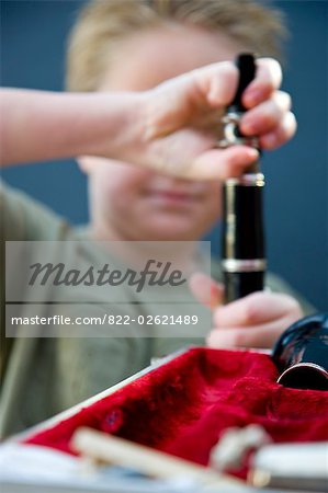 Close up of a boy hands putting together a clarinet Stock Photo - Rights-Managed, Image code: 822-02621489