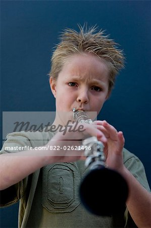 Boy playing the clarinet Stock Photo - Rights-Managed, Image code: 822-02621496
