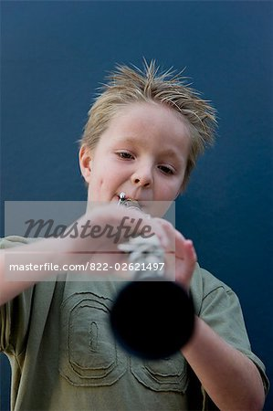 Boy playing the clarinet Stock Photo - Rights-Managed, Image code: 822-02621497