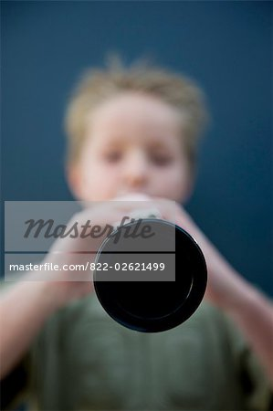 Boy playing the clarinet Stock Photo - Rights-Managed, Image code: 822-02621499