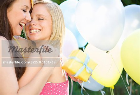 Close up of two smiling teenaged girls at birthday party Stock Photo - Rights-Managed, Image code: 822-03161739