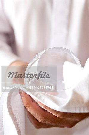 Close up of a waiter's hands polishing a wine glass with a napkin Stock Photo - Rights-Managed, Image code: 822-03161768