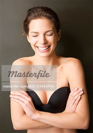 Smiling young woman wearing a strapless black bra Stock Photo - Rights-Managed, Image code: 822-03406706