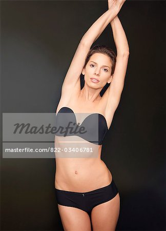 Young woman with arms crossed over head wearing black underwear Stock Photo - Rights-Managed, Image code: 822-03406781