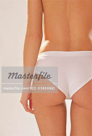 Back view of a woman's body wearing white underwear - headless Stock Photo - Rights-Managed, Image code: 822-03406961
