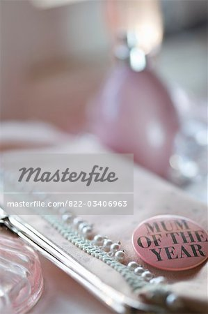 Detail of a clutch bag with a 'mum of the year' badge Stock Photo - Rights-Managed, Image code: 822-03406963