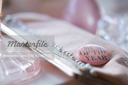 Clutch bag with a 'mum of the year' badge Stock Photo - Rights-Managed, Image code: 822-03407017