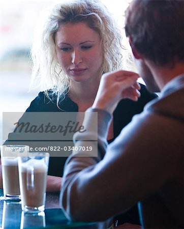 Close up of a young couple sitting in a cafe talking Stock Photo - Rights-Managed, Image code: 822-03407019