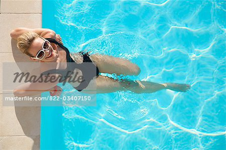 Elevated view of a woman at edge of swimming pool Stock Photo - Rights-Managed, Image code: 822-03407150
