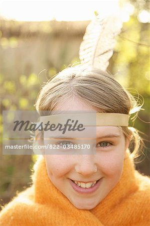 Close up of a girl wearing Indian feather headdress Stock Photo - Rights-Managed, Image code: 822-03485170