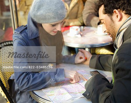 Young couple at cafe looking over a map Stock Photo - Rights-Managed, Image code: 822-03485196