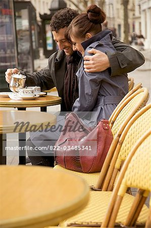 Young couple at outdoor cafe, Paris, France Stock Photo - Rights-Managed, Image code: 822-03485341