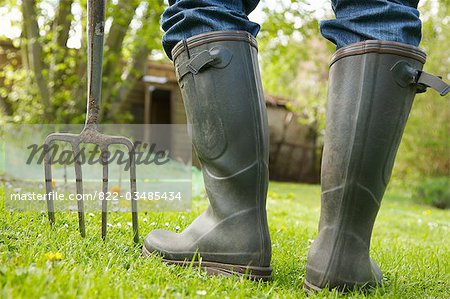 Close up of a man's legs in Wellington boots with pitchfork Stock Photo - Rights-Managed, Image code: 822-03485434