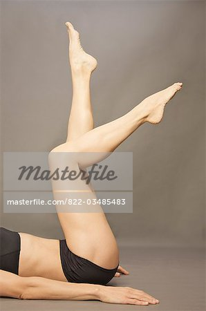 Woman lying on her back with legs raised wearing black underwear, headless Stock Photo - Rights-Managed, Image code: 822-03485483