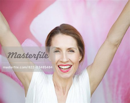 Close up portrait of a woman with arms extended Stock Photo - Rights-Managed, Image code: 822-03485484