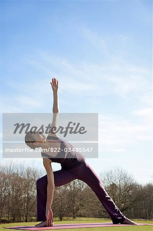 Woman practicing yoga in park Stock Photo - Rights-Managed, Image code: 822-03485547