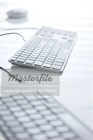 Close up of two computer keyboards Stock Photo - Rights-Managed, Image code: 822-03485553