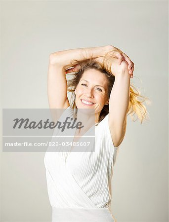 Portrait of a woman with arms crossed over head Stock Photo - Rights-Managed, Image code: 822-03485607