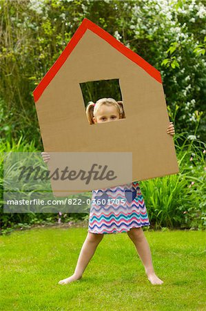 Girl Looking Out from the Window of Cardboard Cut Out in Shape of House Stock Photo - Rights-Managed, Image code: 822-03601705