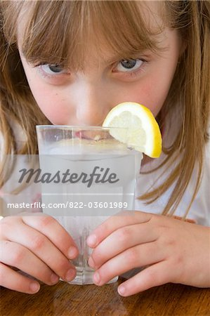 Girl Drinking Water with Ice and Lemon Stock Photo - Rights-Managed, Image code: 822-03601989