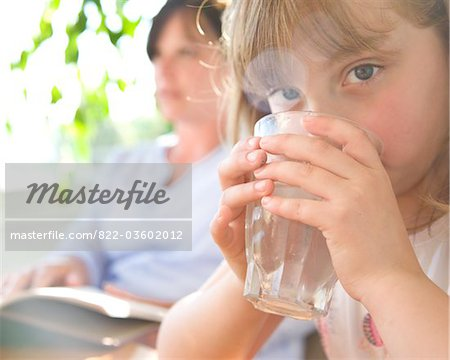 Young Girl Drinking Water Stock Photo - Rights-Managed, Image code: 822-03602012
