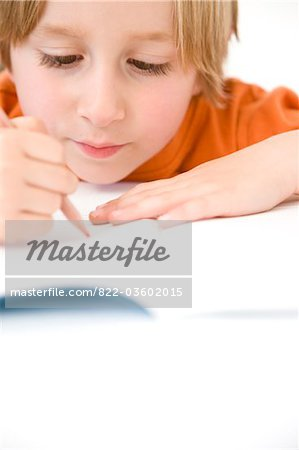 Young Boy Writing Stock Photo - Rights-Managed, Image code: 822-03602015
