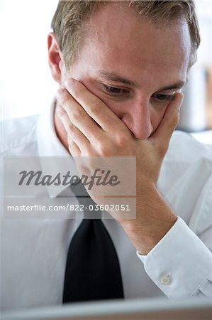Close up of Businessman with Hand Covering Mouth Stock Photo - Rights-Managed, Image code: 822-03602051