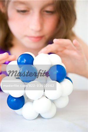 Girl Inspecting Atom Model Stock Photo - Rights-Managed, Image code: 822-03602062