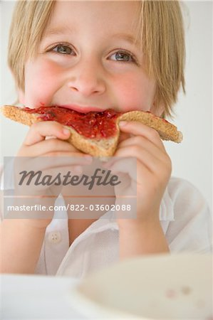 Boy Eating Jam on Toast Stock Photo - Rights-Managed, Image code: 822-03602088