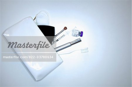 White Purse and its Contents Stock Photo - Rights-Managed, Image code: 822-03780634