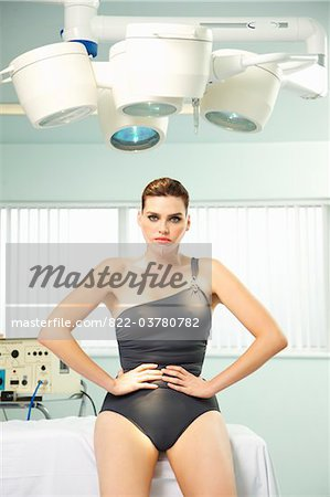 Woman with Elastic Bandage on Face Sitting under Surgical Lamp Stock Photo - Rights-Managed, Image code: 822-03780782