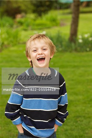 Boy Standing in a Garden with Hands in Pockets Stock Photo - Rights-Managed, Image code: 822-05554419
