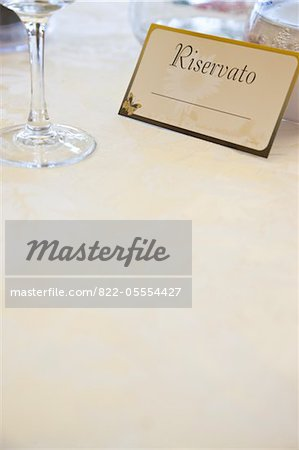 Reserved Sign at Italian Restaurant Stock Photo - Rights-Managed, Image code: 822-05554427