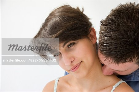 Man Kissing Back of Woman Neck Stock Photo - Rights-Managed, Image code: 822-05554432