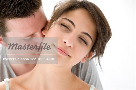 Man Kissing Back of Woman Neck Stock Photo - Rights-Managed, Image code: 822-05554508