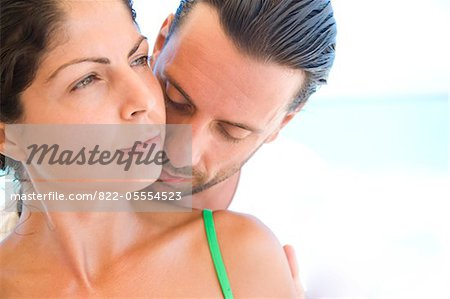 Man Kissing Woman Shoulder from Behind Stock Photo - Rights-Managed, Image code: 822-05554523