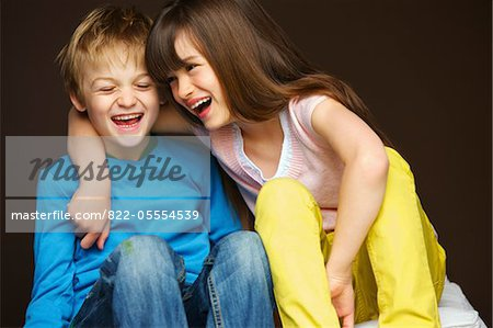 Boy and Girl Hugging and Laughing Stock Photo - Rights-Managed, Image code: 822-05554539