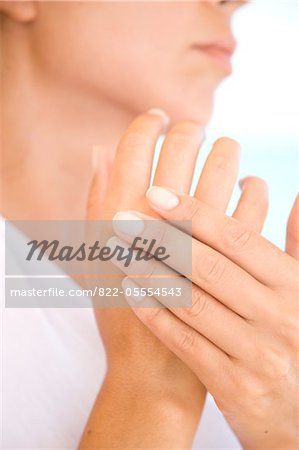 Woman Massaging Hands, Close-up view Stock Photo - Rights-Managed, Image code: 822-05554543