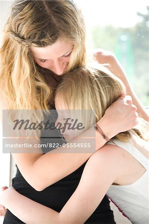 Mother and Daughter Hugging Stock Photo - Rights-Managed, Image code: 822-05554555