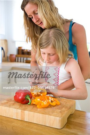 Mother and Daughter Slicing Bell Peppers Stock Photo - Rights-Managed, Image code: 822-05554578